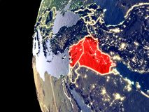 Territory of Islamic State on globe from space. Night view of Islamic State from space with visible city lights. Very detailed plastic planet surface. 3D stock illustration