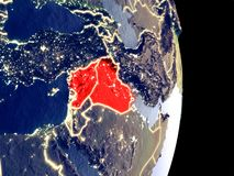 Territory of Islamic State on night Earth. Satellite view of Islamic State at night with visible bright city lights. Extremely fine detail of the plastic planet royalty free illustration