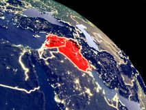 Territory of Islamic State from space. Islamic State at night from orbit. Plastic planet surface with visible city lights. 3D illustration. Elements of this vector illustration