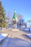 On territory of Kremlin in city Nizhny Novgorod. NIZHNY NOVGOROD, RUSSIA - March 14.2015: Little temple chapel and monument to the founders of city on territory Stock Photo