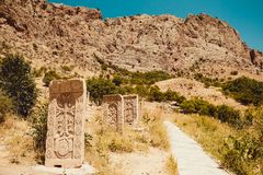 Territory Noravank monastery with khachkars. Armenian culture. Architecture concept. Pilgrimage place. Religion background. Travel. To Armenia. Tourism industry Royalty Free Stock Image