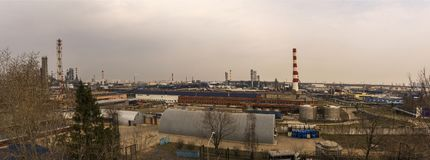 The territory of the power plant. Factory buildings with pipes, Panorama of 3 images royalty free stock images