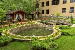 Territory of Sanatorium Edelweiss in the resort city of Belokurikha in the Altai Krai. Belokurikha, Russia - July 12, 2015: Territory of Sanatorium Edelweiss in Stock Photos