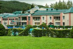 Territory of Sanatorium Transsib in the resort city of Belokurikha in the Altai Krai. Belokurikha, Russia - July 12, 2015: Territory of Sanatorium Transsib in Stock Image