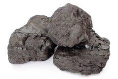 Terrones del carbón en el fondo blanco Fotografía de archivo