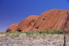 Terrones y topetones de Uluru Imagen de archivo libre de regalías