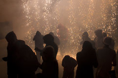 Terror. BARCELONA - JUNE 26: Some unidentified people during a typical spanish fire festival called correfoc or fireruns where people enjoys with fire and Stock Image