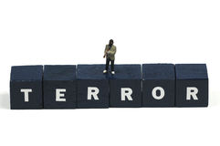 Terror. A terrorist standing on the word terror stock image