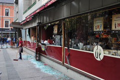 Terror attack in Oslo. A fast food employee cleaning broken glass after terror attack in Oslo 22.07.2011 Royalty Free Stock Photography