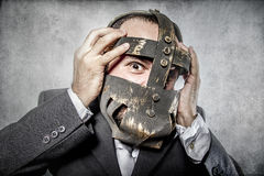 Terror, business man with iron mask Stock Photo