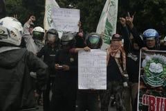 Terror do destacamento 88 da polícia do protesto da rejeição anti em Chester Indonesia Imagens de Stock