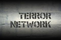 Terror network GR. Terror network stencil print on the grunge white brick wall Stock Image
