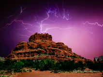 Terror over Bell Rock. A spider web of lightning flashing over Bell Rock near Sedona Arizona during a monsoon storm. Spider lightning usually occurs when a storm Stock Images