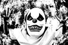 Terror Scare. Crazy clown mask halloween costume and fear royalty free stock photo
