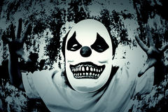 Terror Scare. Crazy clown mask halloween costume and fear Stock Images