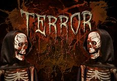 Terror skeletons. Two scary skeletons with the word Terror in the background royalty free stock image