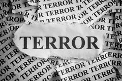 Terror. Torn pieces of paper with the word Terror. Concept Image. Black and White. Close-up stock photo