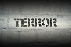 Terror word gr. Terror stencil print on the grunge white brick wall stock photography