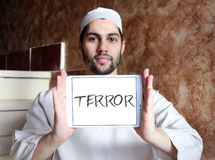 Terror. Word on white tablet holded by smiling arab religious muslim man stock images