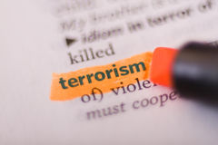 Terrorism. Close-up of Terrorism word in dictionary marked by orange