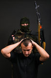 Terrorism. Terrorist in a traditional clothing and a hostage stock photography