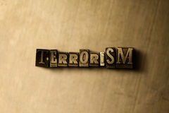 TERRORISM - close-up of grungy vintage typeset word on metal backdrop Royalty Free Stock Image