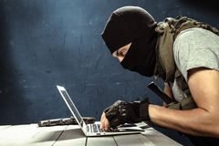 Terrorism concept. Terrorist working on his computer. Terrorism concept Royalty Free Stock Photos