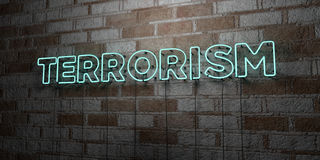 TERRORISM - Glowing Neon Sign on stonework wall - 3D rendered royalty free stock illustration Royalty Free Stock Photo