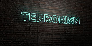 TERRORISM -Realistic Neon Sign on Brick Wall background - 3D rendered royalty free stock image Royalty Free Stock Images
