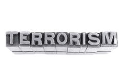 Terrorism sign, antique metal letter type Royalty Free Stock Photo