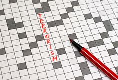 Terrorism. Text in crossword. Red letters stock photos