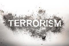 Terrorism word written in ash, dust, dirt as awful, dangerous, f Stock Photo