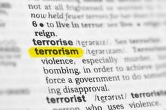 Terrorismo inglês destacado da palavra e sua definição no dicionário imagens de stock royalty free