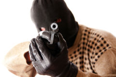 Terrorist. A  terrorist shooting camera with his pistol Royalty Free Stock Photography