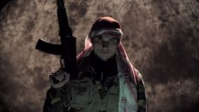 Terrorist With Automatic Rifle Looks in the Camera stock footage