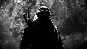 Terrorist With Automatic Rifle Looks in the Camera stock video footage