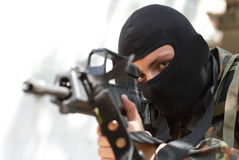 Terrorist in black mask with a gun Royalty Free Stock Photo