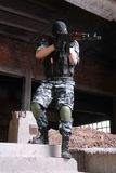 Terrorist in black mask targeting with a gun Stock Images
