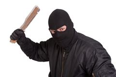 Terrorist in black uniform with big knife Stock Image