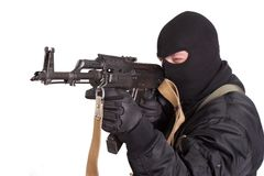 Terrorist in black uniform and mask with kalashnikov isolated Royalty Free Stock Images