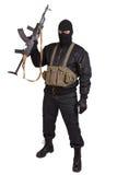 Terrorist in black uniform and mask with kalashnikov Royalty Free Stock Photography