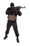Terrorist in black uniform and mask with kalashnikov isolated Stock Photography