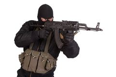 Terrorist in black uniform and mask with kalashnikov isolated Royalty Free Stock Photo