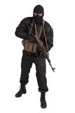Terrorist in black uniform and mask with kalashnikov isolated Royalty Free Stock Photos
