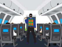 Terrorist with a bomb in salon of the plane. Stock Photography