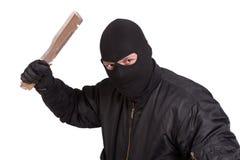 Terrorist in der schwarzen Uniform mit großem Messer stockbild
