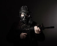Terrorist with gas mask Stock Photos