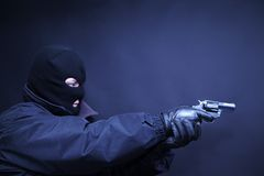 Terrorist with gun aimed shoot. Terrorist in a mask with gun in his hand aimed shoot Stock Photos
