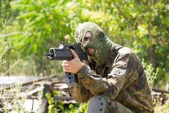 Terrorist with a gun outdoors Stock Photo