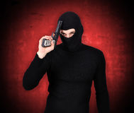 Terrorist with gun Royalty Free Stock Image